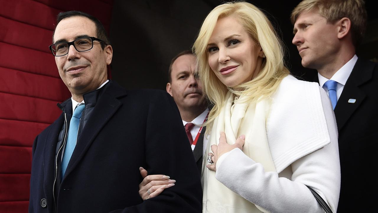 Then Treasury Secretary-designate Stephen Mnuchin and his then-fiancee, Louise Linton, arrive on Capitol Hill in Washington, for the presidential inauguration on Jan. 20, 2017.