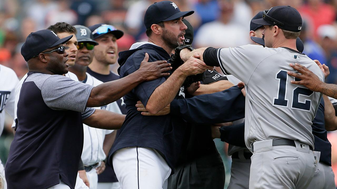 Detroit Tigers hitting coach Lloyd McClendon, left, tries to pull Justin Verlander, center, away from New York Yankees Chase Headley during the second bench-clearing of the game.