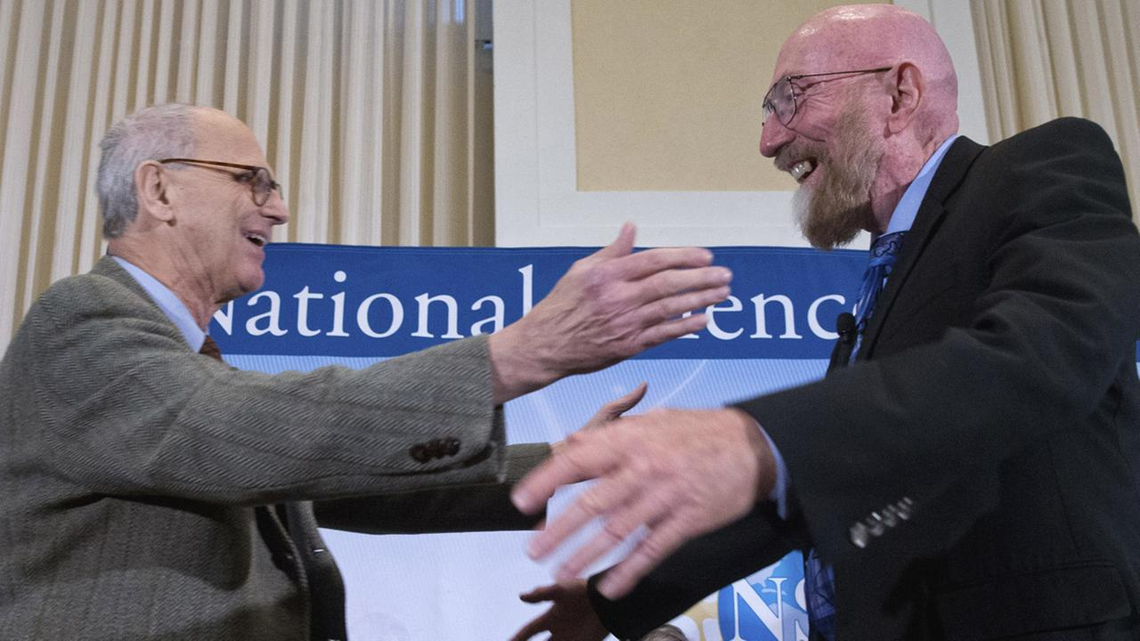In this Feb. 11, 2016 file photo, Laser Interferometer Gravitational-Wave Observatory (LIGO) Co-Founder Rainer Weiss, left, and Kip Thorne, right, hug on stage.