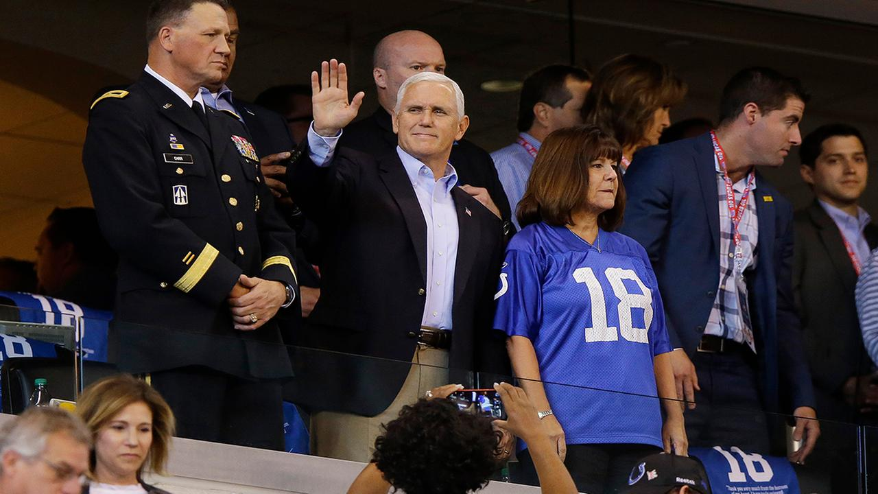 Vice President Mike Pence waves to fans before a game between the Colts and the 49ers, Sunday, Oct. 8, 2017, in Indianapolis. (AP Photo/Michael Conroy)