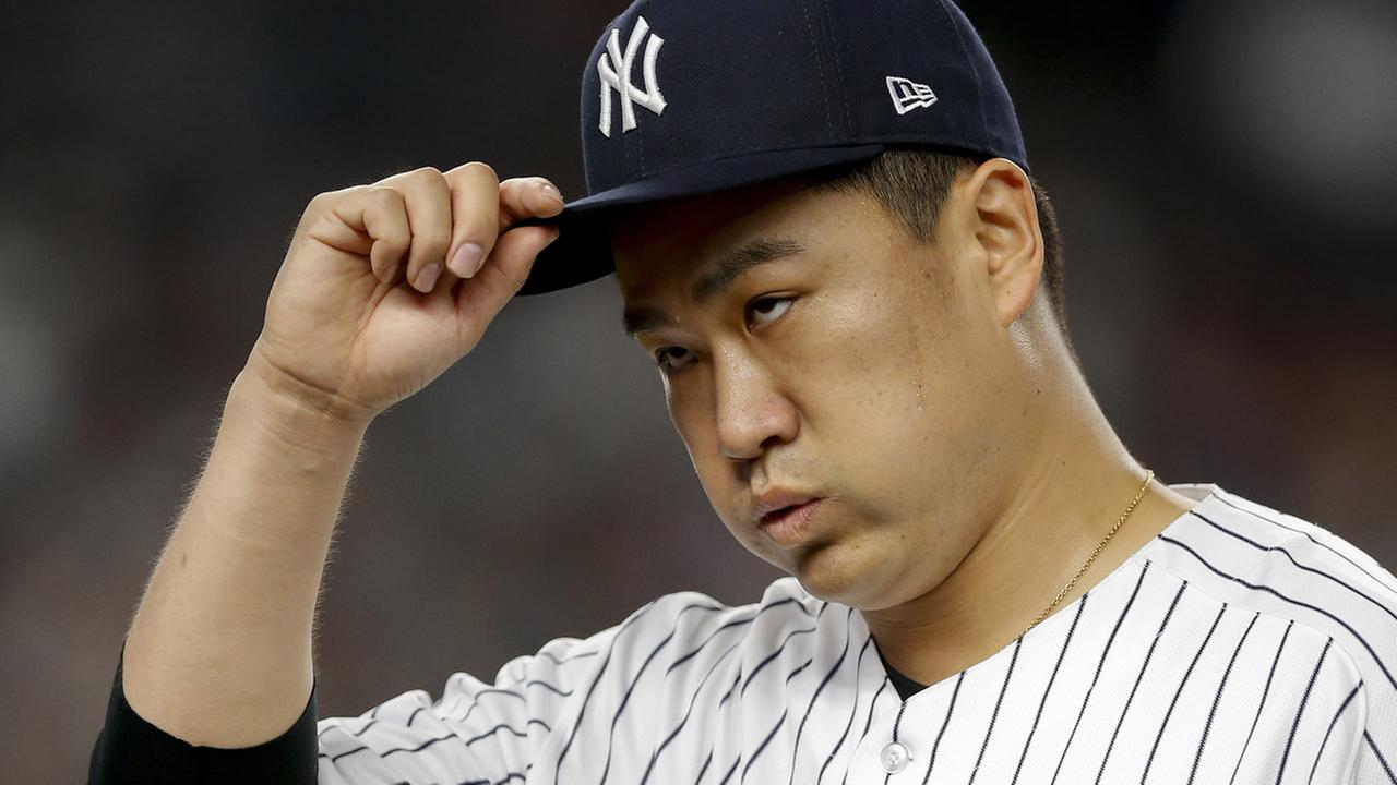New York Yankees pitcher Masahiro Tanaka (19) walks off the field at the end of the second inning against the Cleveland Indians in Game 3 of baseballs ALDS.