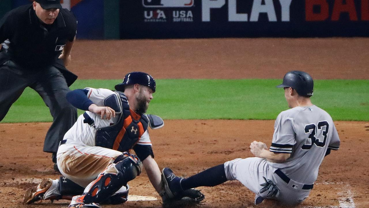 Houston Astros catcher Brian McCann tags out New York Yankees Greg Bird at home during the fifth inning of Game 7 of American League Championship Series. (AP Photo/Charlie Riedel)