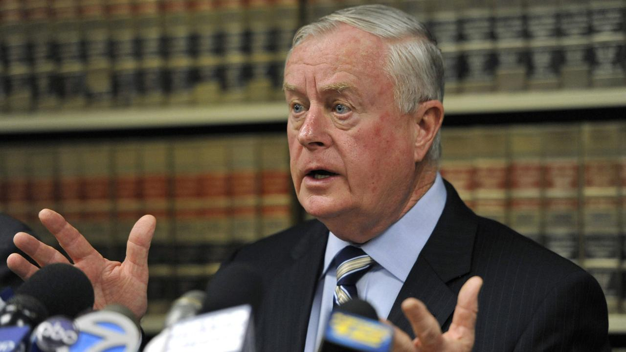 NY prosecutor to retire after being charged in beating cover-up