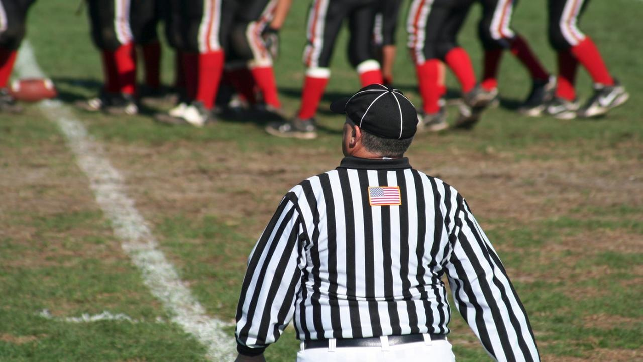 2 referees refuse to work high school game after national anthem protest