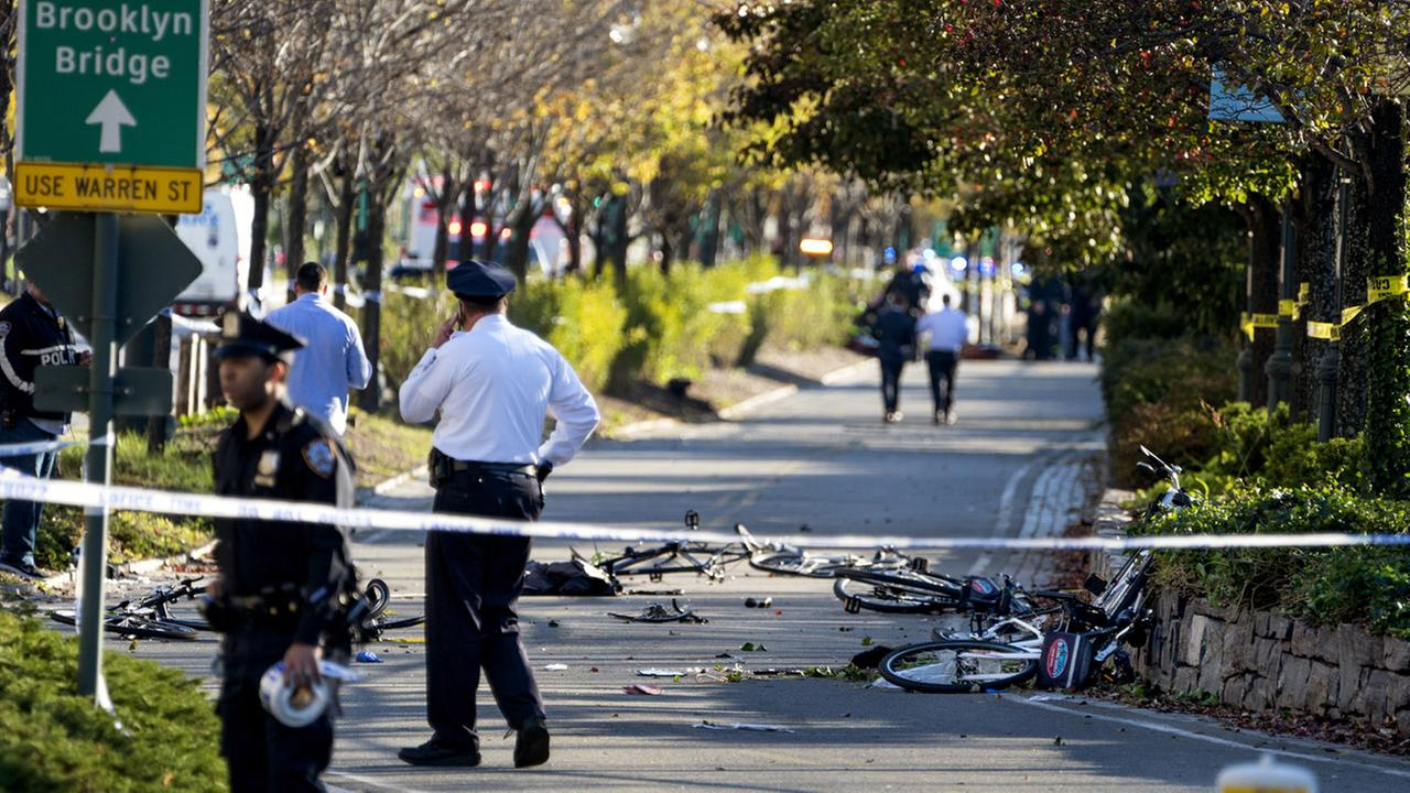 Bicycles and debris lay on a bike path after a motorist drove onto the path near the World Trade Center memorial, striking and killing several people Tuesday, Oct. 31, 2017.