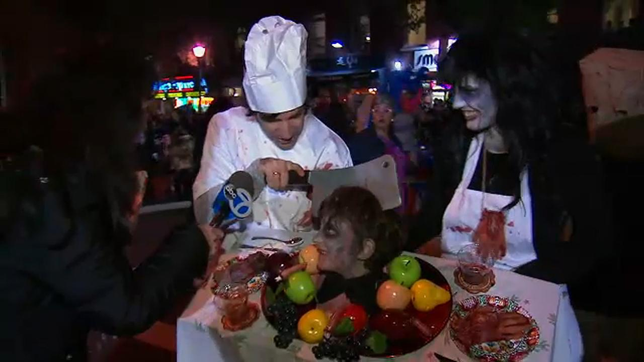 Halloween parade marches on amid heavy security after attack