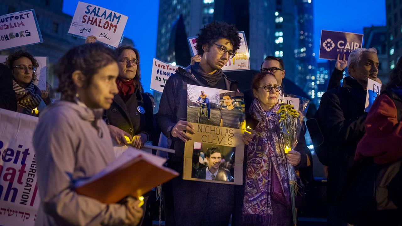 Bahij Chancey, 26, holds a photo of his friend and, one of the victims Nicholas Cleves, during a vigil for peace at Foley Square in response to the Manhattan truck attack.