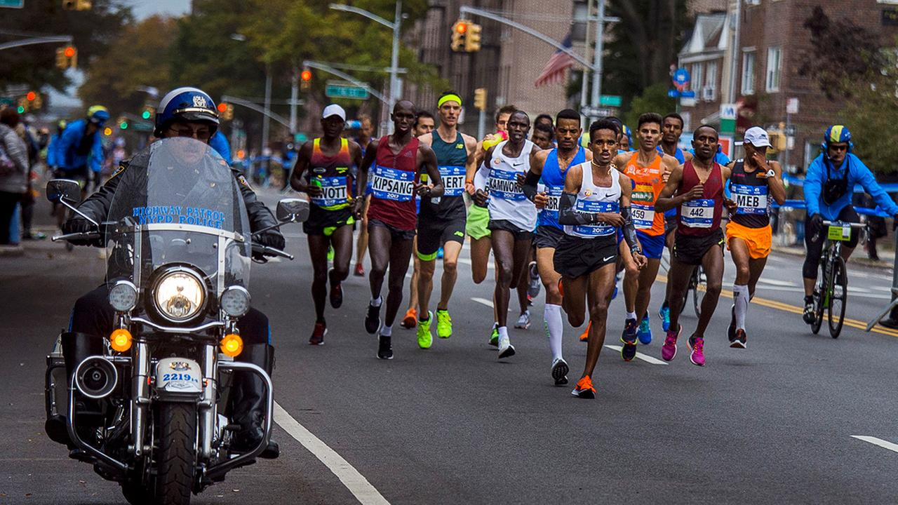 Elite mens runners move along 4th Avenue in the Brooklyn borough of New York during the New York City Marathon on Sunday, Nov. 5, 2017. (AP Photo/Andres Kudacki)