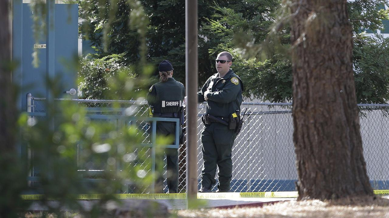 Law enforcement officers are seen at an elementary school in the community of Rancho Tehama Reserve, where a gunman opened fire Tuesday, Nov. 14, 2017, in Corning, California.