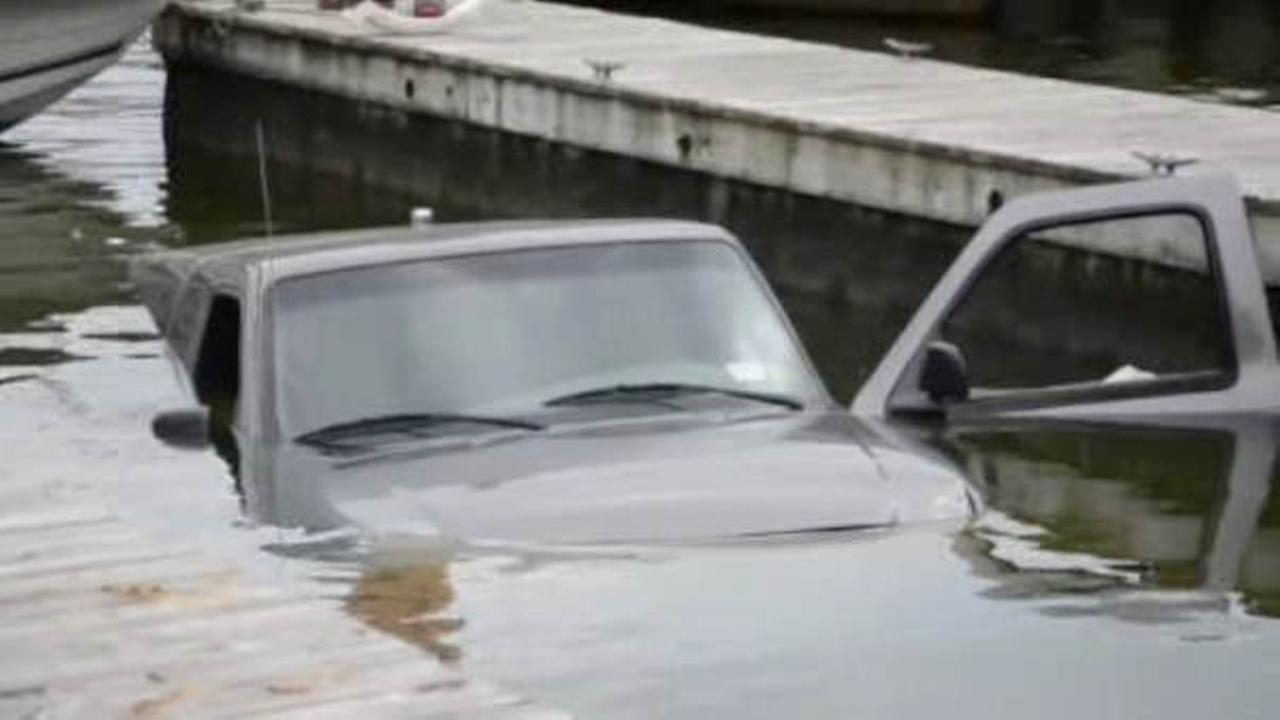 Man's truck ends up in water along with boat, trailer