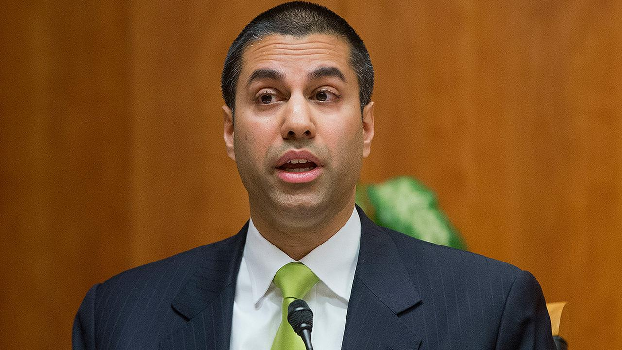 Federal Communication Commission Commissioner Ajit Pai speaks during an open hearing and vote on Net Neutrality in Washington.