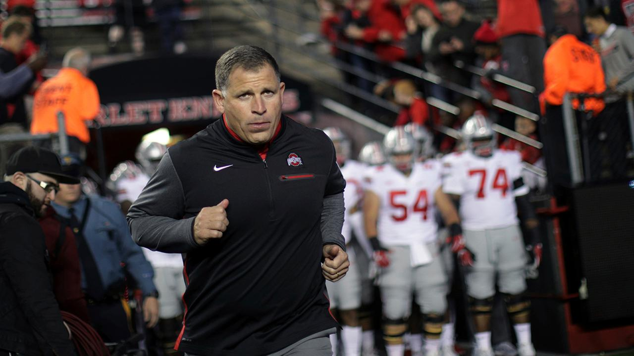 Ohio State associate head coach/defensive coordinator Greg Schiano runs onto the field before a game against Rutgers, Saturday, Sept. 30, 2017 (AP Photo/Mel Evans)