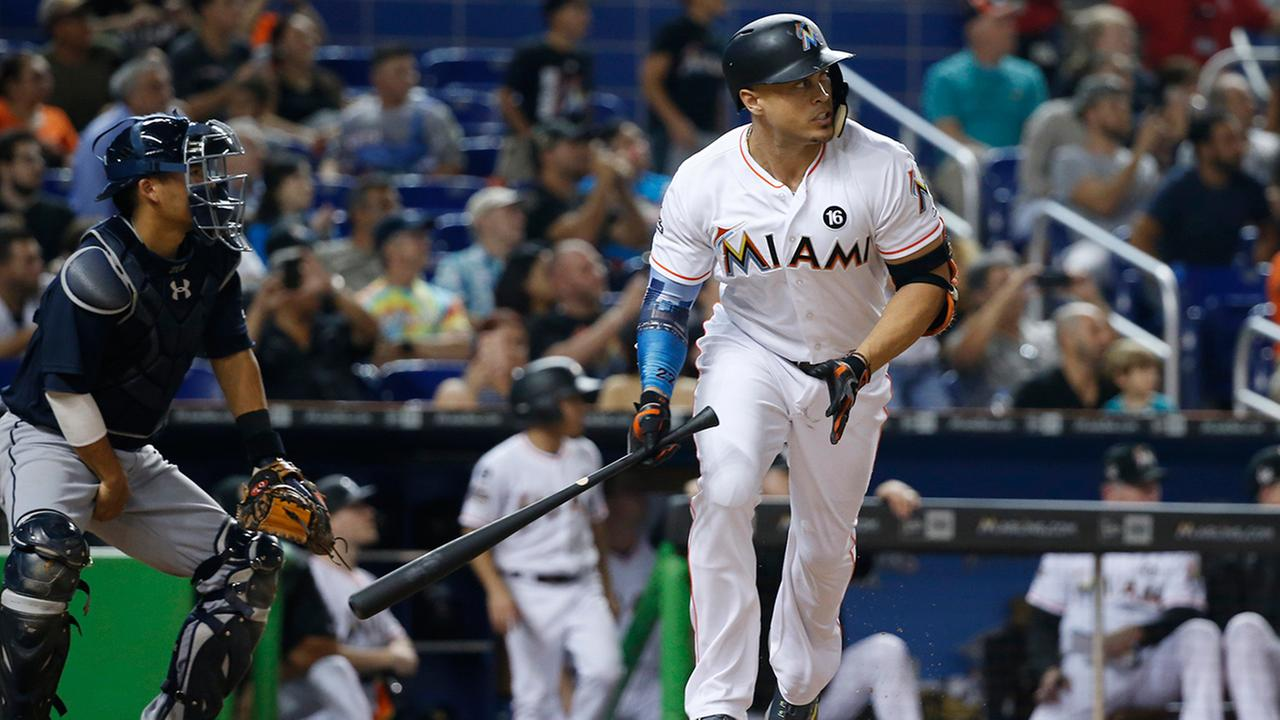 Miami Marlins Giancarlo Stanton hits a double during the sixth inning of a baseball game against the Atlanta Braves, Friday, Sept. 29, 2017, in Miami.  (AP Photo/Wilfredo Lee)