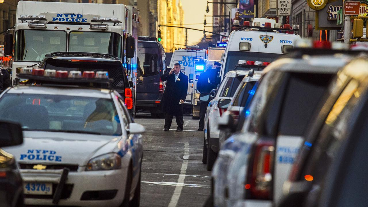 Police block a street by Port Authority Bus Terminal near New Yorks Times Square following an explosion on Monday, Dec. 11, 2017.