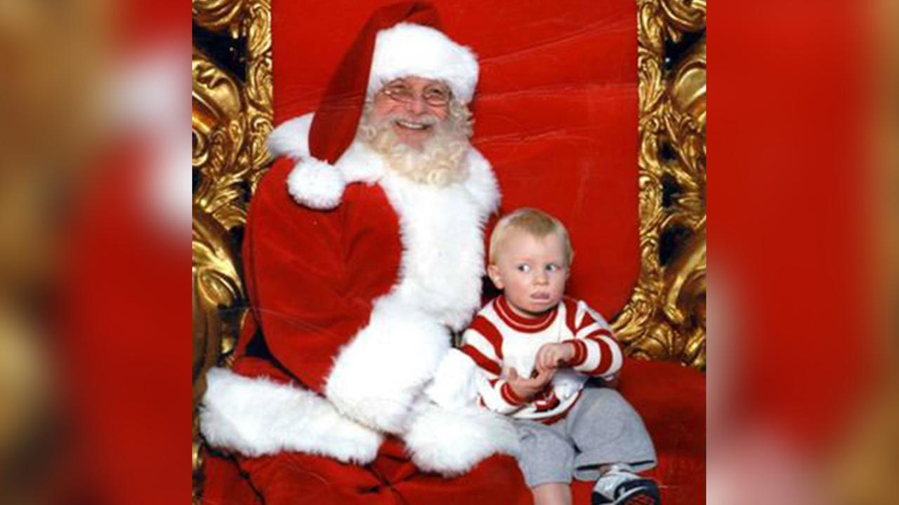 Every year, hilarious photos of children with Santa surface on social media, but a womans photo of her one-year-old baby using sign language to signal for help has gone viral.