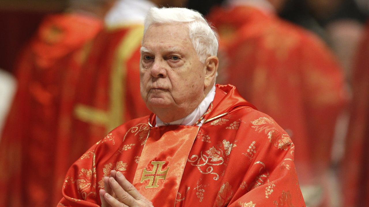 US Cardinal Bernard Law attends a Mass for the election of a new pope inside St. Peters Basilica, at the Vatican, Tuesday, March 12, 2013.