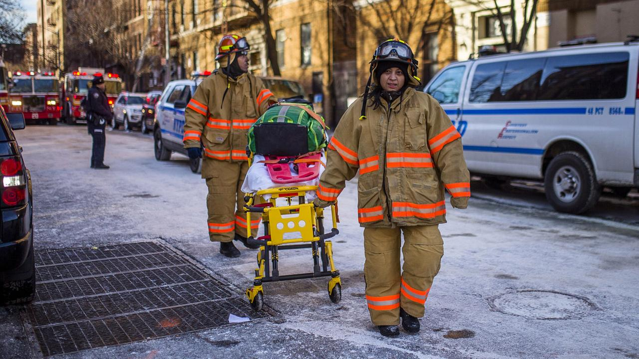 'Police stand guard as paramedics leave the scene near the building Friday, Dec. 29, 2017, where more than 10 people died in a fire on Thursday in the Bronx.' from the web at 'http://cdn.abclocal.go.com/content/wabc/images/cms/2838408_1280x720.jpg'