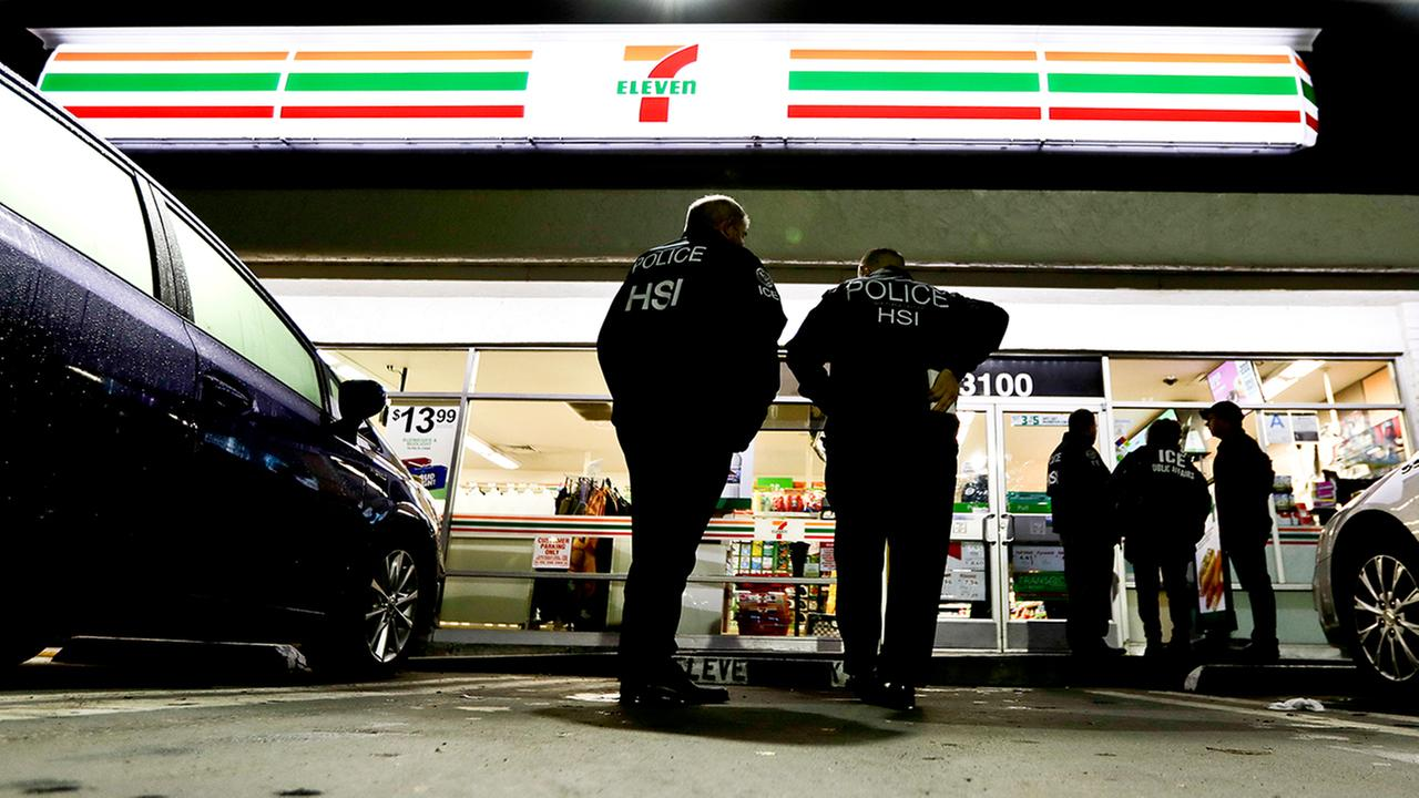 U.S. Immigration and Customs Enforcement agents serve an employment audit notice at a 7-Eleven convenience store in Los Angeles. (AP Photo/Chris Carlson)