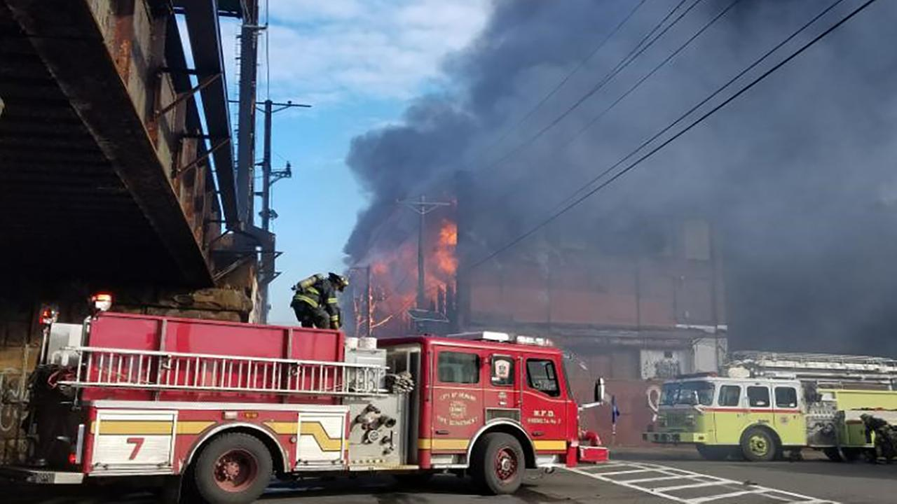 NJ Transit and Amtrak Trains Suspended Due to Building Fire Near Tracks