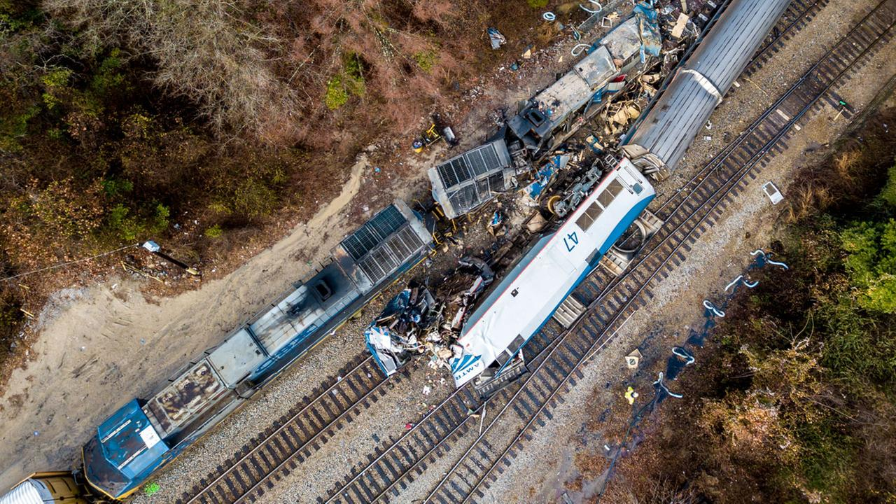 An aerial view of the site of an early morning train crash Sunday, Feb. 4, 2018 between an Amtrak train, bottom right, and a CSX freight train, top left, in Cayce, SC.