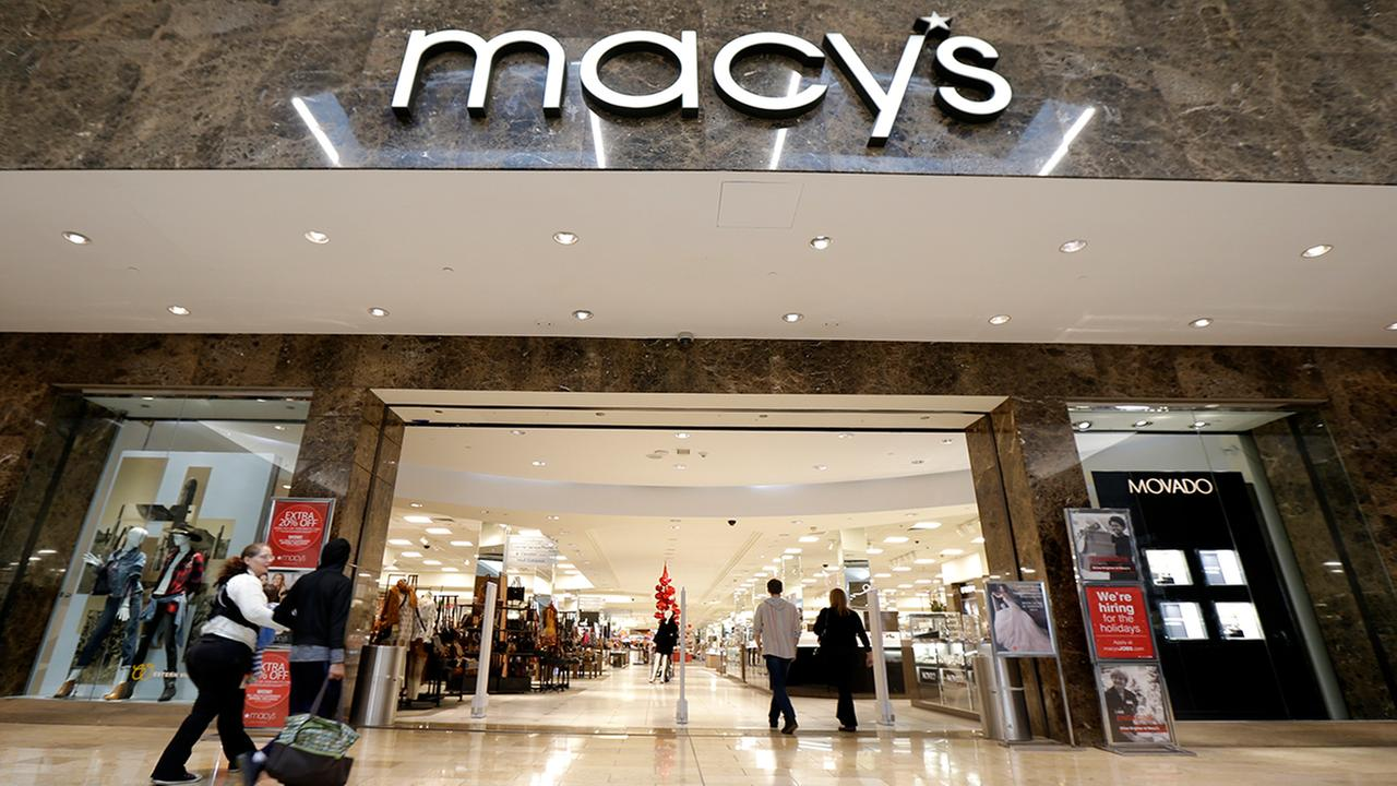 People walk into an entrance to Macys department store at Garden State Plaza, Wednesday, Oct. 25, 2017, in Paramus, N.J. (AP Photo/Julio Cortez)