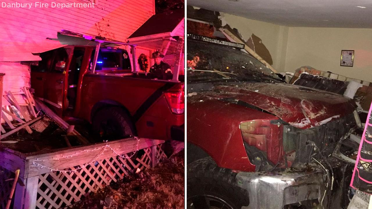 Truck crashes into house, injures occupants in Danbury, Connecticut