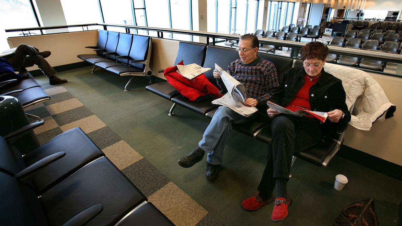 Passengers waiting for a Skybus flight at Stewart International Airport. (AP Photo/Craig Ruttle)