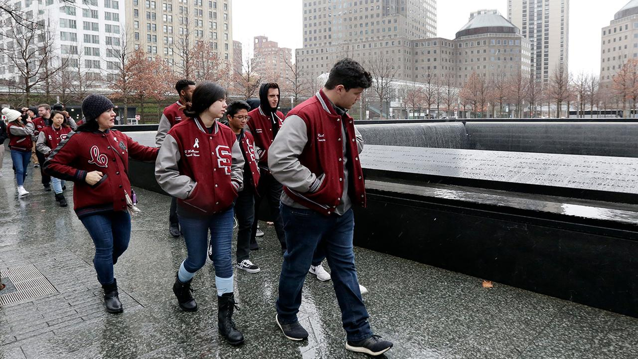 tudents from Marjory Stoneman Douglas High School Wind Symphony, in Parkland, Fla., walk by the south reflecting pool during their visit to the 9/11 Museum and Memorial, in New York,