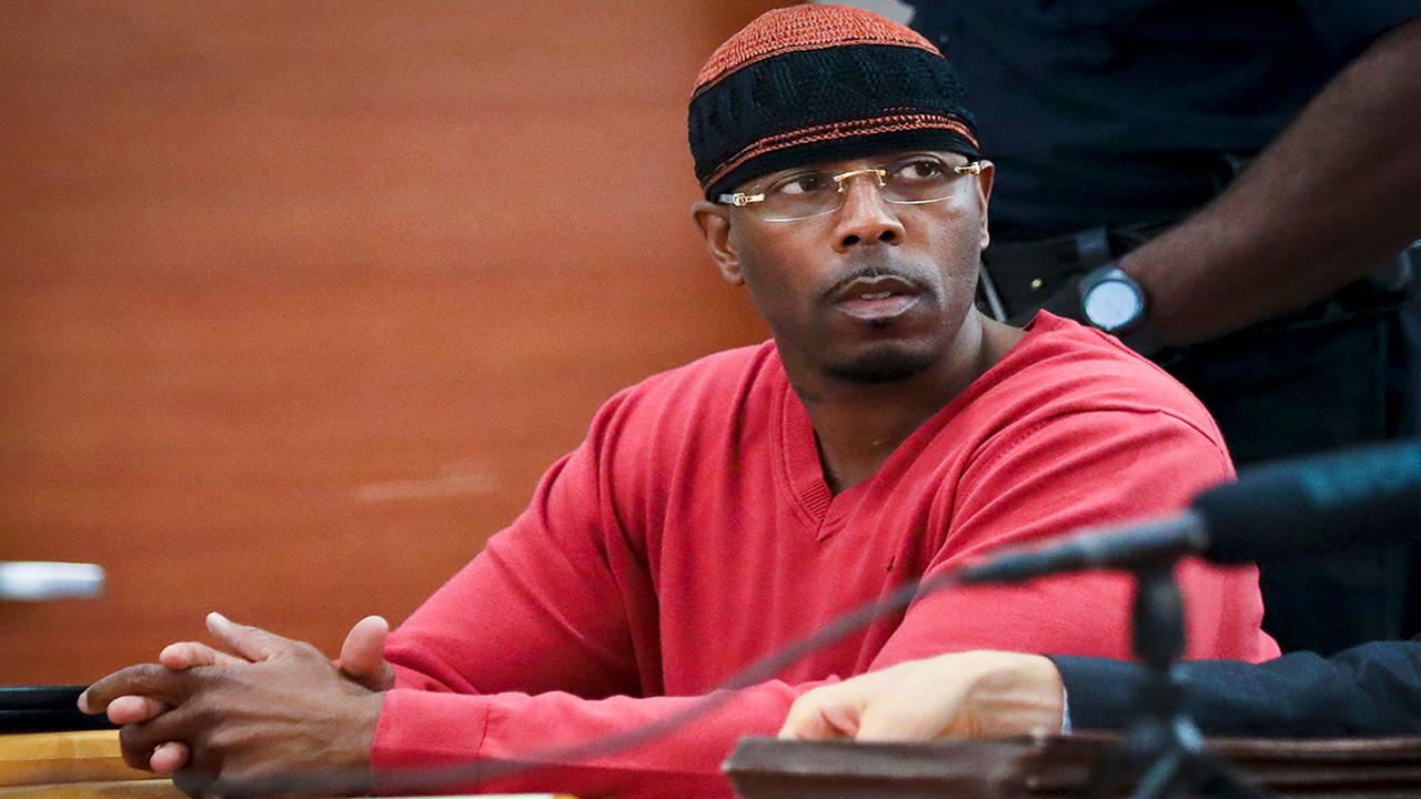 In this May 5, 2017, file photo, Calvin Buari listens during a hearing at Bronx Criminal Court to vacate his double murder conviction, in New York. (AP Photo/Bebeto Matthews, File)