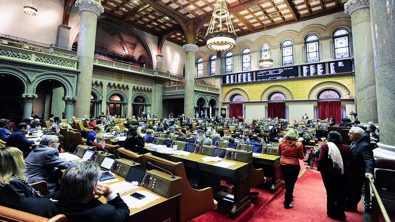 Members of the New York Assembly work on passing budget bills at the state Capitol Friday, March 30, 2018, in Albany, N.Y. (AP Photo/Hans Pennink)