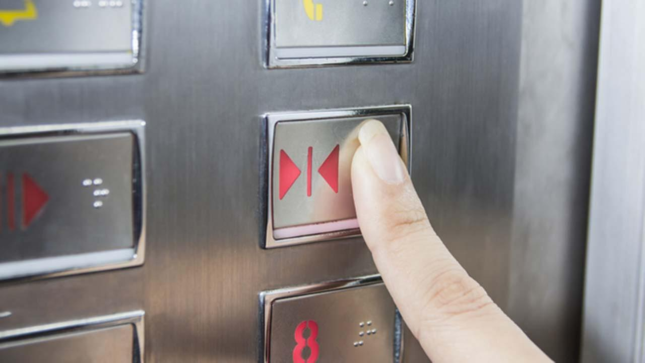 Elevator door close button