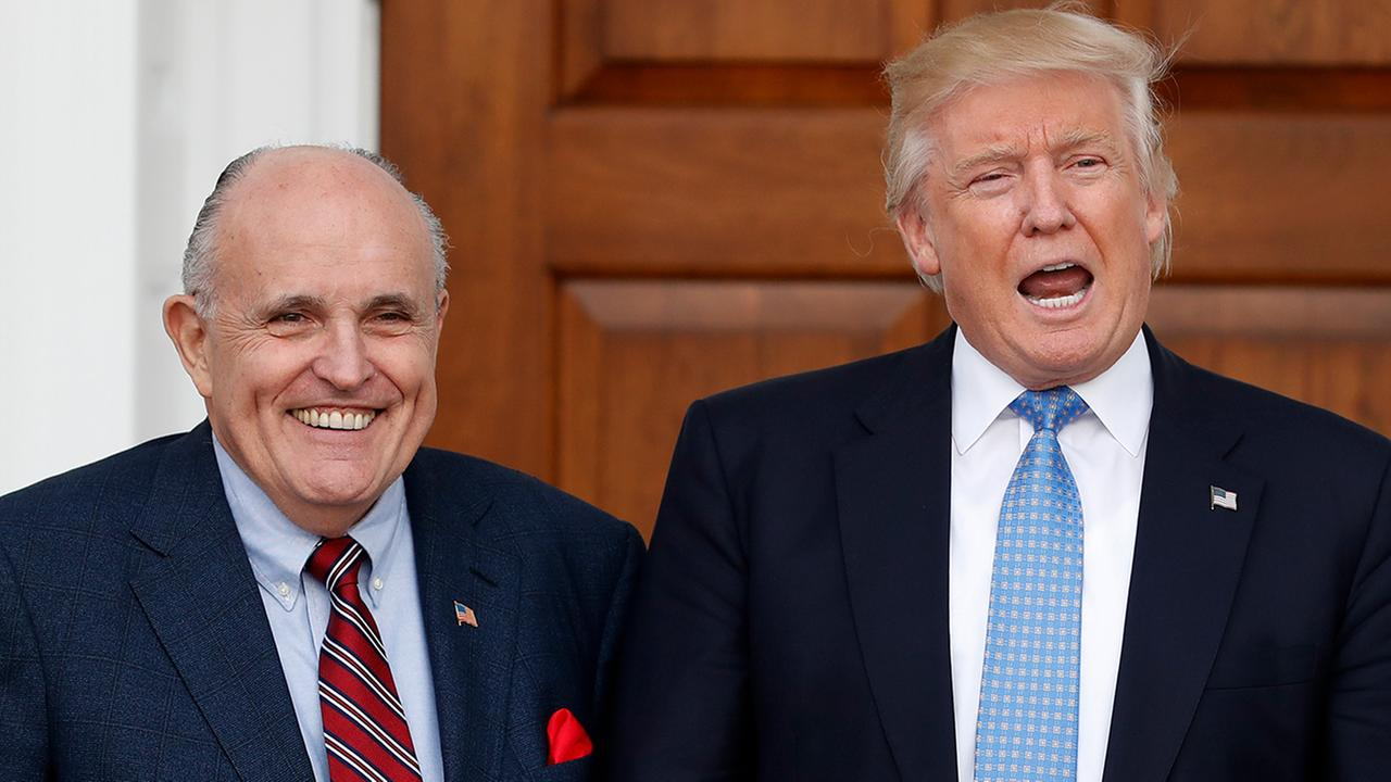 President Trump and former New York Mayor Rudy Giuliani at the Trump National Golf Club Bedminster clubhouse, Nov. 20, 2016, in Bedminster, N.J..(AP Photo/Carolyn Kaster)
