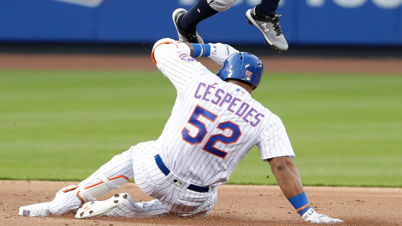 New York Mets Yoenis Cespedes (52) slides for a double during the first inning of a baseball game Wednesday, May 2, 2018, in New York. (AP Photo/Frank Franklin II)