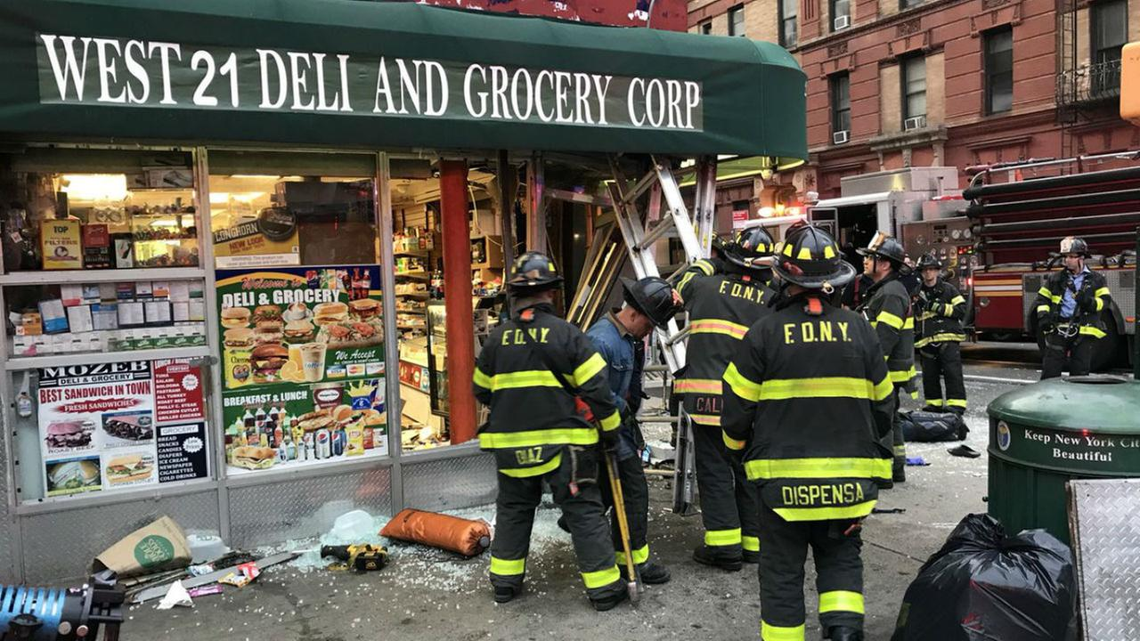 Auto  hits building in Chelsea, injuring several people, FDNY says