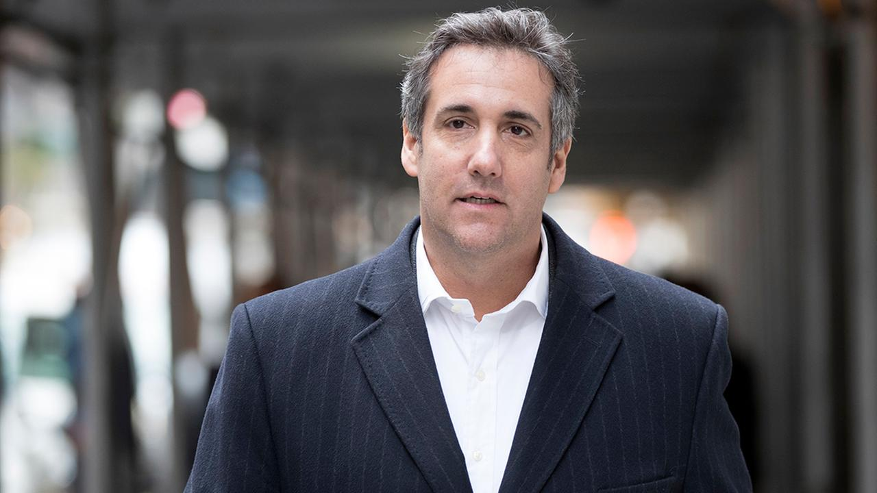 Attorney Michael Cohen walks down the sidewalk in New York, Wednesday, April 11, 2018, in New York. (AP Photo/Mary Altaffer)