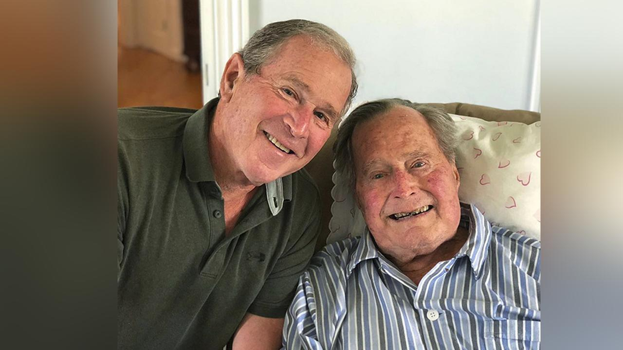 In this photo provided by the Office of George W. Bush, former presidents George H.W. Bush and his son pose in Maine, June 12, 2018. (Office of George W. Bush via AP)