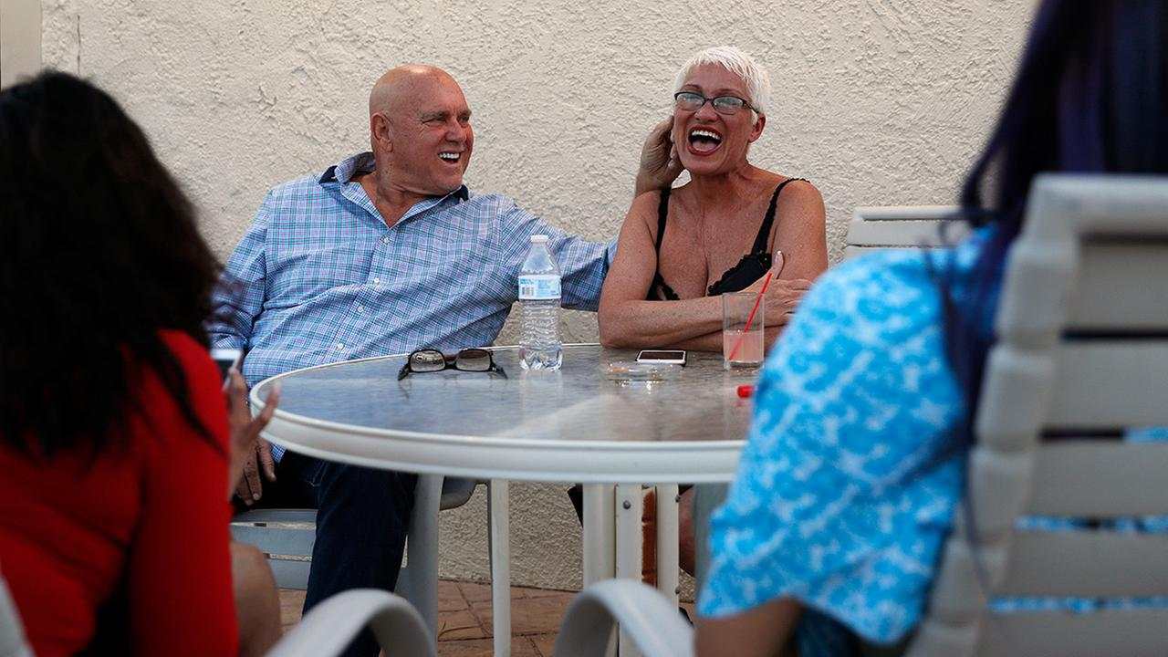 In this April 27, 2018, photo, owner Dennis Hof, left, jokes with madam Sonja Bandolik at the Love Ranch brothel in Crystal, Nevada
