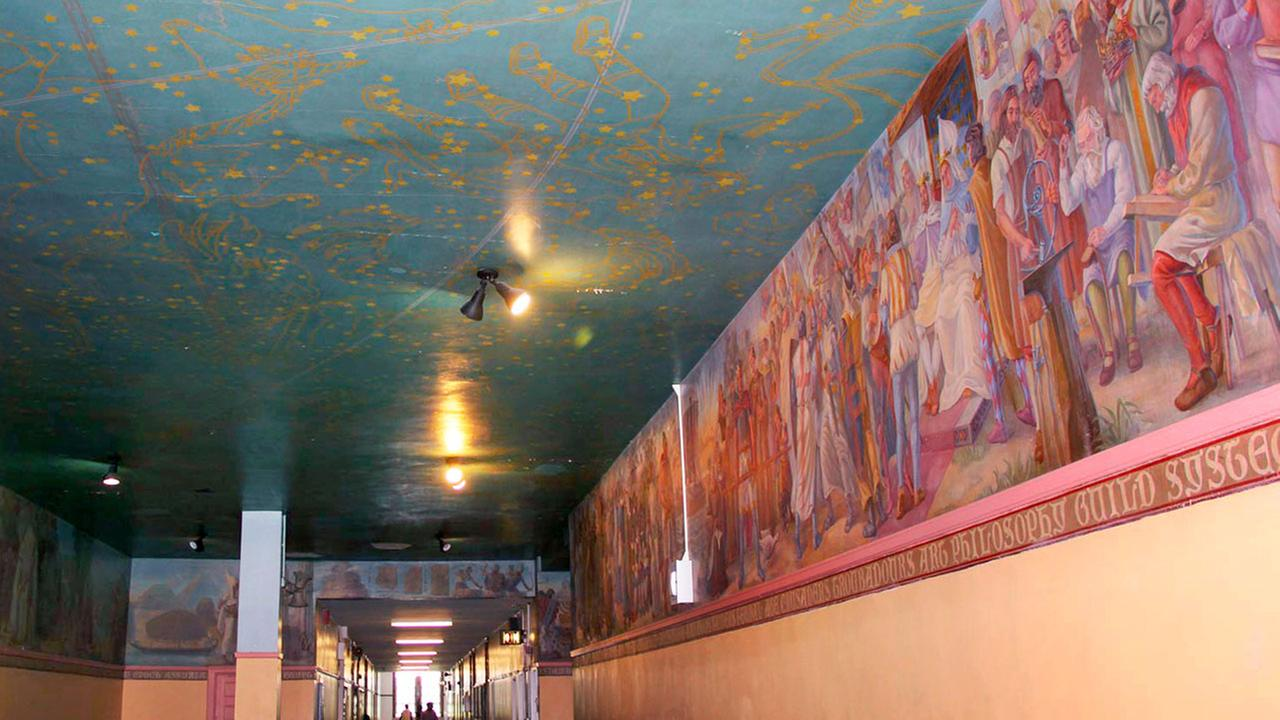 This Aug. 5, 2015 photo shows a mural painted in the 1930s by Alfred Floegel on the walls and ceiling of the third-floor hallway at DeWitt Clinton High School in the Bronx