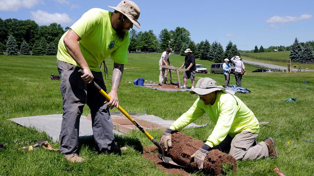 Jesse Pagels, left, and Edgar Alarcon, of the Public Archaeology Facility at Binghamton University, start a new dig at the site of the original Woodstock Music and Art Fair