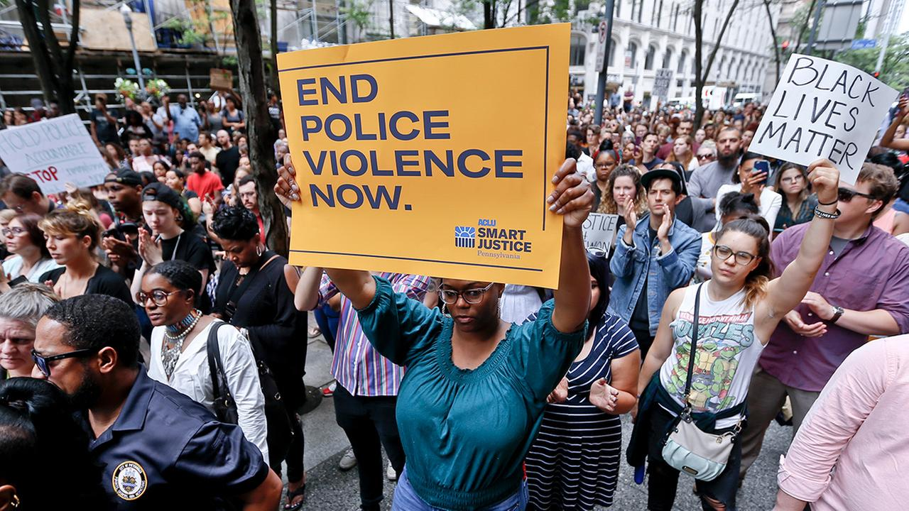 Protestors rally in front of the Allegheny County Courthouse on Thursday, June 21, 2018, in Pittsburgh.