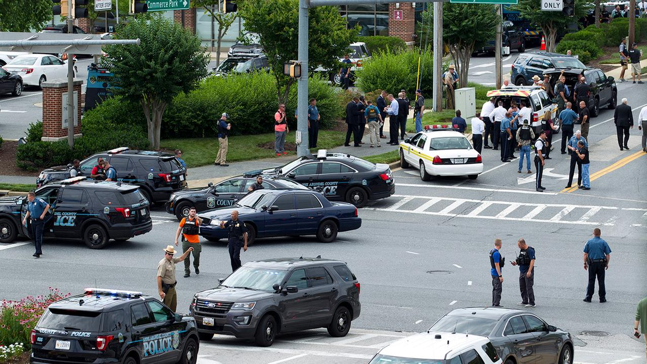 Newspaper shooting suspect 'barricaded exit'