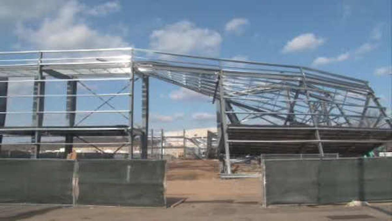 2 injured when airport hangar under construction collapses in morristown nj for Architecture hangar
