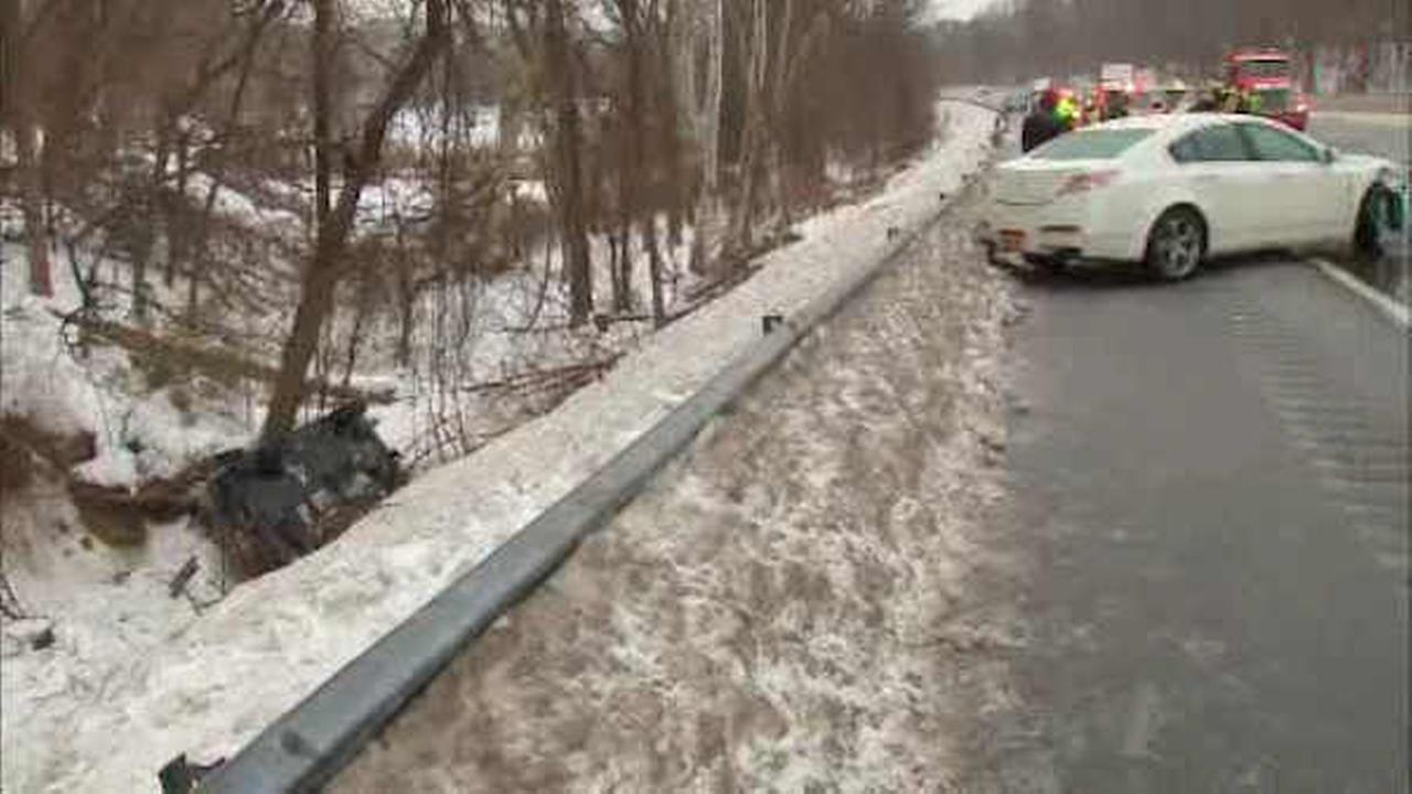 An SUV slid down an embankment after an accident on the New York State Thruway in Ardsley.