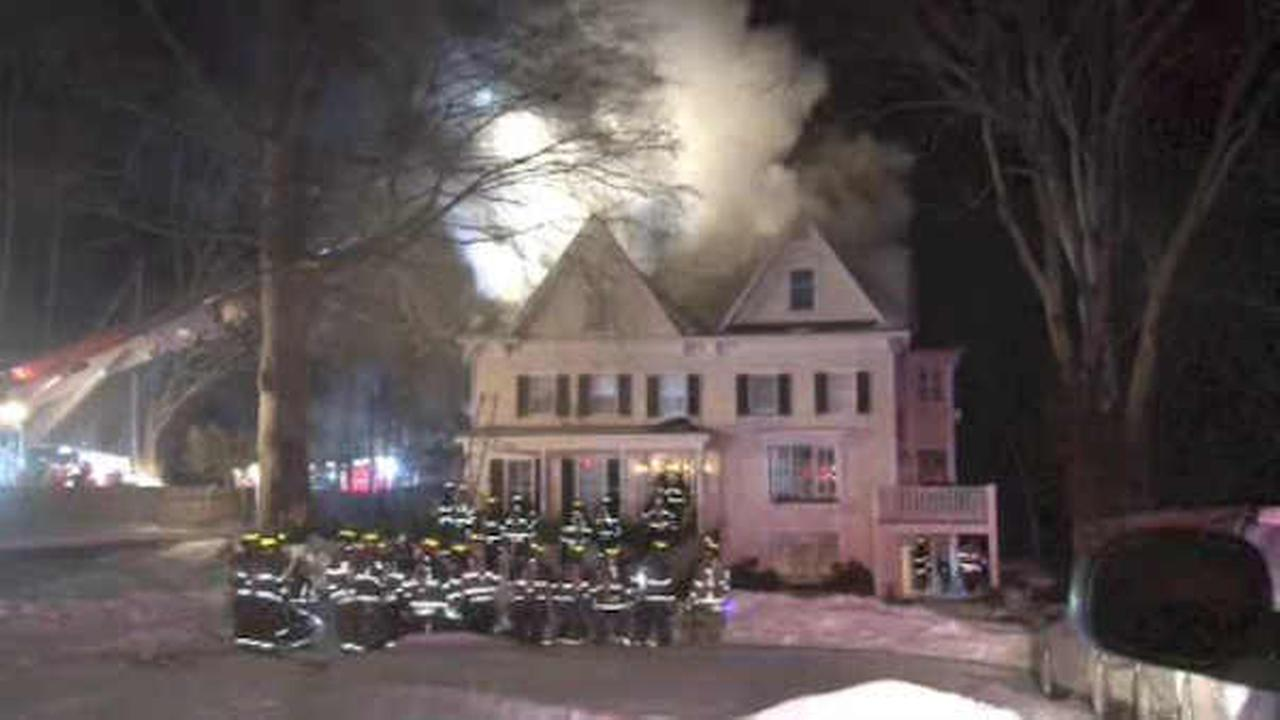 Firefighters work against cold and snow while battling fire in Bedford Hills