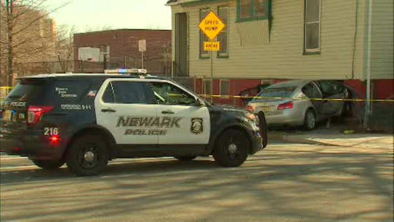 photos newark police chase ends with car into house suspect shot. Black Bedroom Furniture Sets. Home Design Ideas