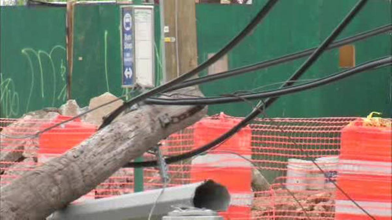 Truck clips wires and pole on Francis Lewis Boulevard in Queens