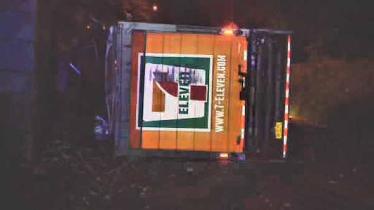 2 hurt when tractor-trailer hits LIRR bridge in Center Moriches