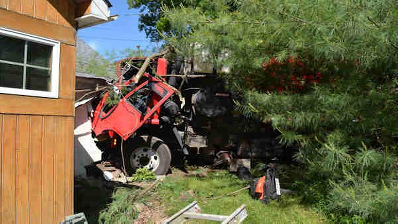 street sweeper crashes into home