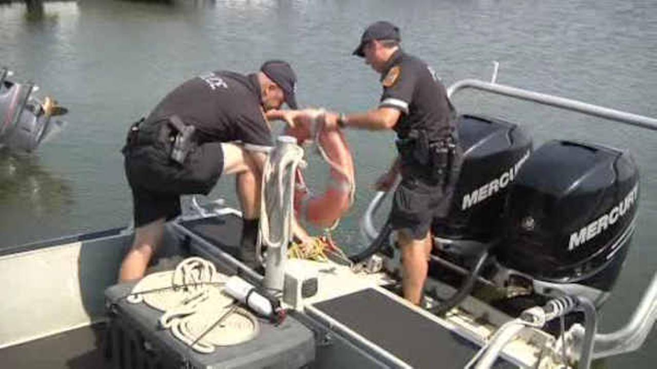 Police and lifeguard rescue 3 men from rip current off Fire Island