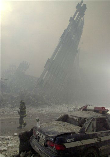 "<div class=""meta image-caption""><div class=""origin-logo origin-image none""><span>none</span></div><span class=""caption-text"">Destroyed mullions are the only thing left standing behind a lone fireman, after a terrorist attack on the twin towers of lower Manhattan Tuesday, Sept. 11, 2001. (AP Photo/ MARK LENNIHAN)</span></div>"